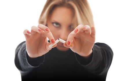 young woman breaking cigarette isolated on white background